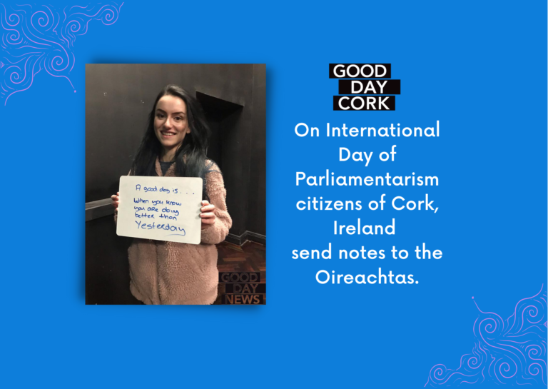 Text reads: On International Day of Parliamentarism citizens of Cork, Ireland send notes to the Oireachtas with photograog of girl holding a sign that reads A good day is when you're doing better than yesterday.